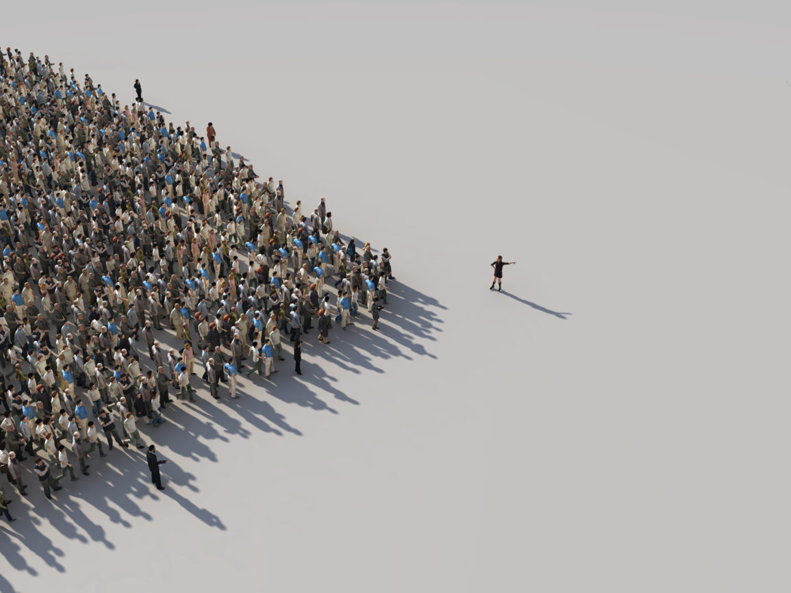 A person leading a pack of people