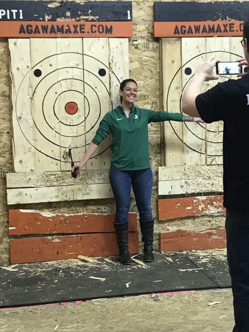 SWC staffer celebrating at an axe throwing event